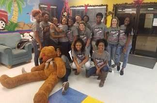 Paris High School varsity girls basketball team donates to Children's Care Center