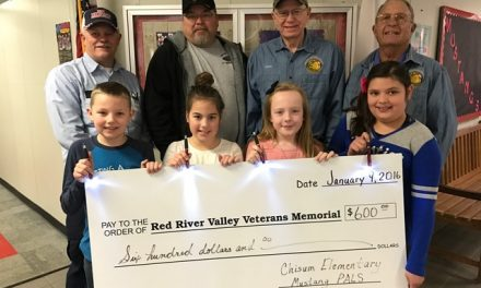 Chisum students present check to local Veteran Memorial