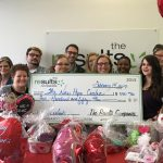 Paris Results Company presents check to New Hope Center of Paris