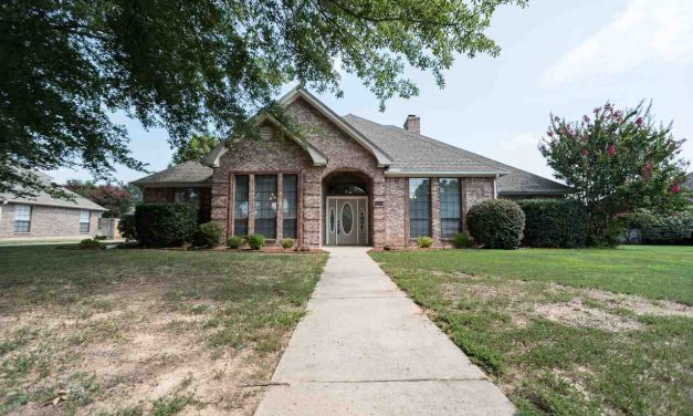 PRICE REDUCED – Stunning home with 3 living spaces