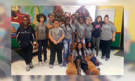 Paris High School varsity girls basketball team delivers donations