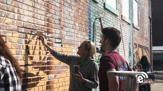 Local artist and students help restore historical mural in downtown Paris, Texas