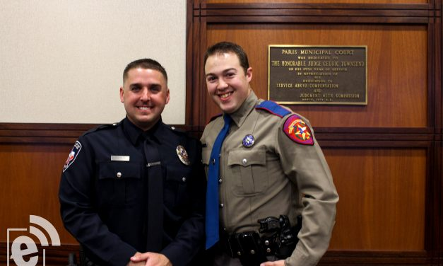Cousin pins the badge for new Paris Police Officer Trey Haislip