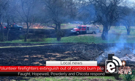 Volunteer firefighters extinguish out-of-control burn pile