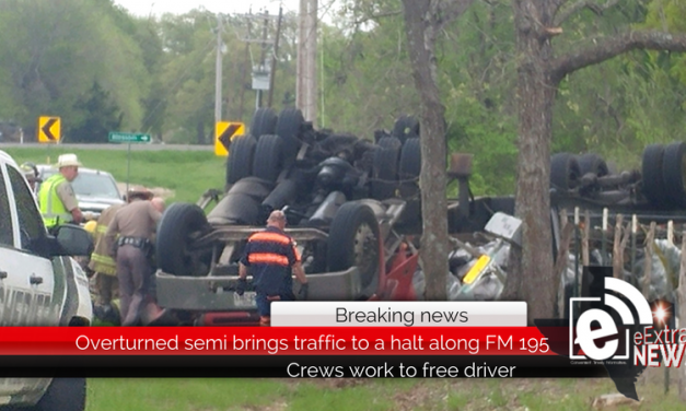 Overturned semi brings traffic to a halt, Crews work to free driver • Updated 11:51 a.m.