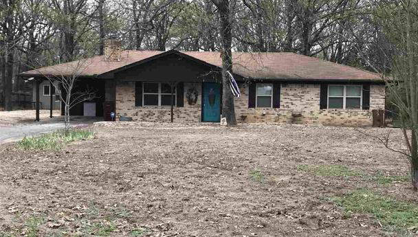 Country home on one acre located in Powderly, Texas
