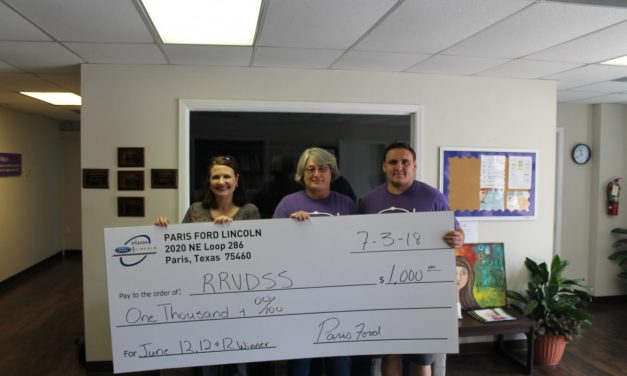 Paris Ford Lincoln awards another $1,000 to local agency