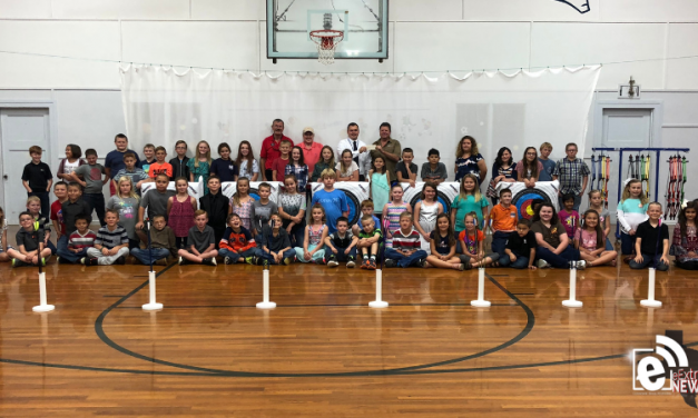 Denver Pyle's Children's Charities makes donation to Deport Elementary School