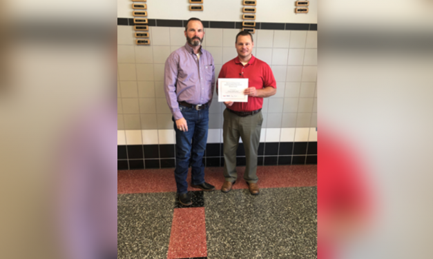 Exxon Mobile makes donation to Chisum Middle School