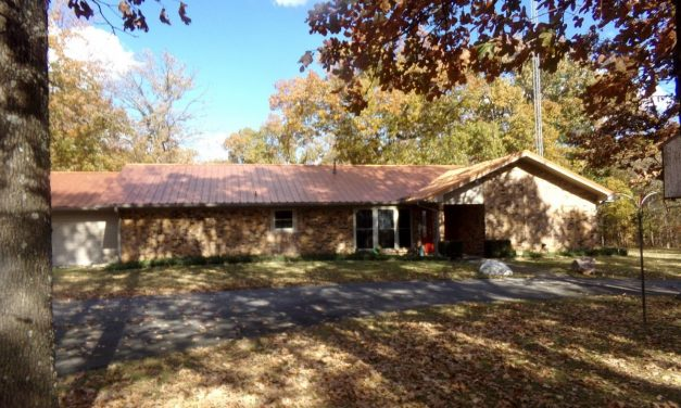Country home and land for sale in Powderly, Texas    $264,900